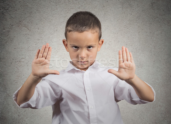 Boy giving stop gesture with hands Stock photo © ichiosea