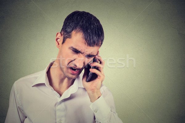 Angry business man screaming on the mobile phone Stock photo © ichiosea