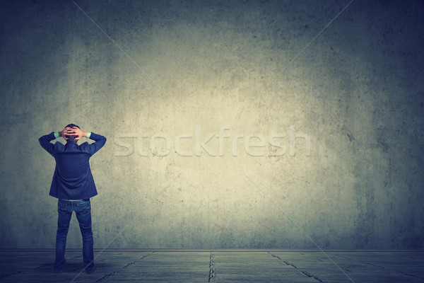 Full length of business man facing the wall  Stock photo © ichiosea