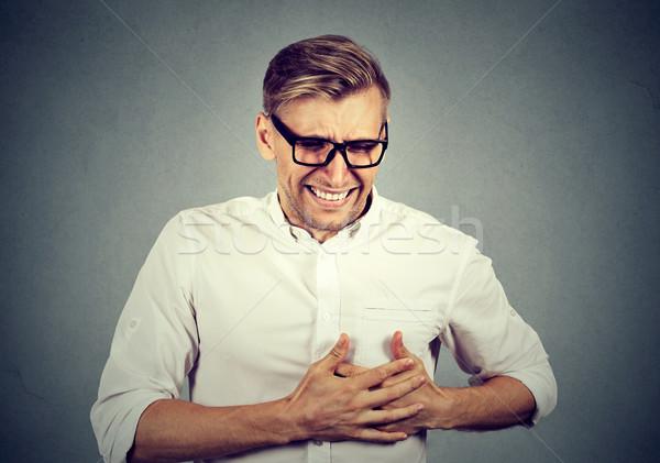 Volwassen man lijden scherp hartzeer borst Stockfoto © ichiosea
