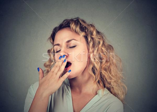 Sleepy young woman yawning eyes closed looking bored Stock photo © ichiosea