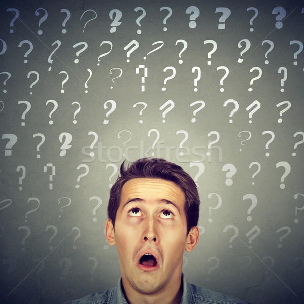 Confused curious shocked man has many questions and no answer   Stock photo © ichiosea