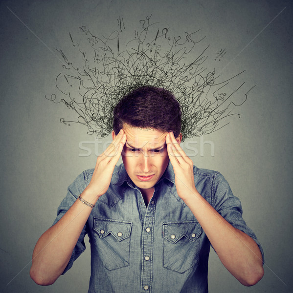 sad man with stressed face expression brain melting into lines  Stock photo © ichiosea