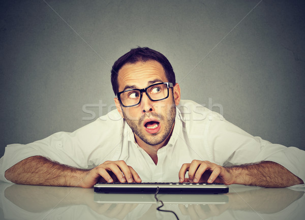 Man typing on the keyboard wondering what to reply  Stock photo © ichiosea