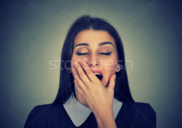 Sleepy woman with wide open mouth yawning looking bored  Stock photo © ichiosea