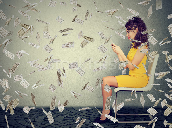 Successful woman using a mobile phone building online business making money  Stock photo © ichiosea