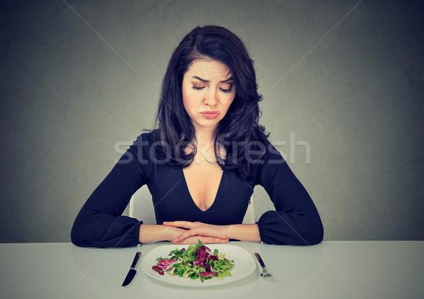 Woman having dissatisfying diet Stock photo © ichiosea