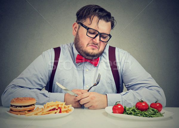 Man suffering from diet choice Stock photo © ichiosea