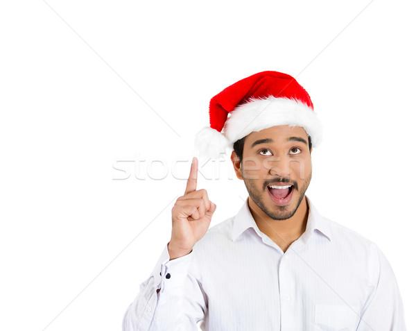 человека красный Hat указывая вверх Сток-фото © ichiosea