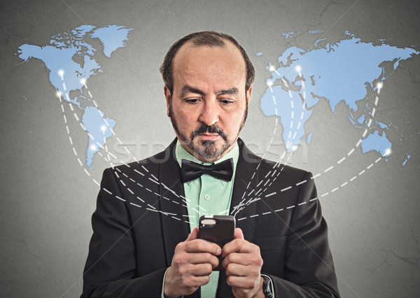Business man holding smartphone connected browsing internet  Stock photo © ichiosea