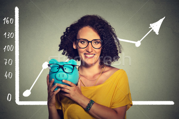 Woman happy and excited over savings on buying eyewear glasses Stock photo © ichiosea
