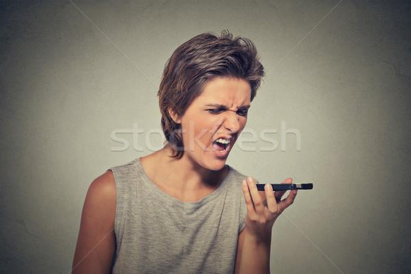 Enojado gritando teléfono móvil retrato aislado Foto stock © ichiosea