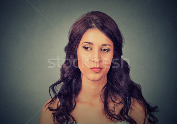 confused skeptical woman thinking about past Stock photo © ichiosea