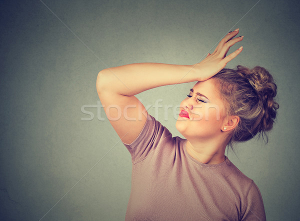 Regrets wrong doing. Silly woman, slapping hand on head having duh moment Stock photo © ichiosea