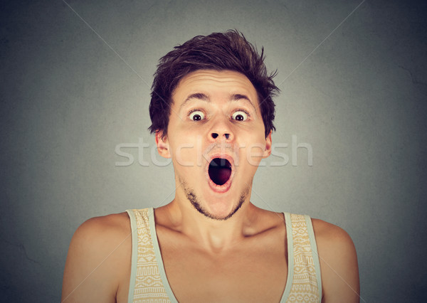 shocked surprised young man in full disbelief screaming  Stock photo © ichiosea