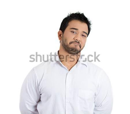 Közelkép portré szkeptikus fiatalember vicces gyanús Stock fotó © ichiosea