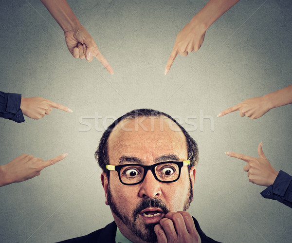 Concept social accusation of guilty businessman fingers pointing at him  Stock photo © ichiosea