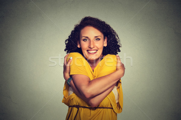 happy smiling woman holding hugging herself  Stock photo © ichiosea