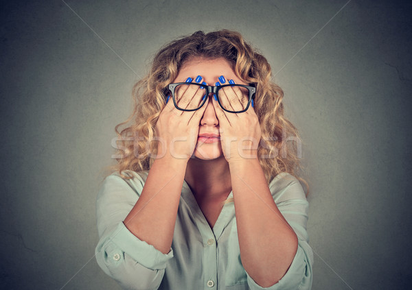 woman in glasses covering face eyes with both hands Stock photo © ichiosea