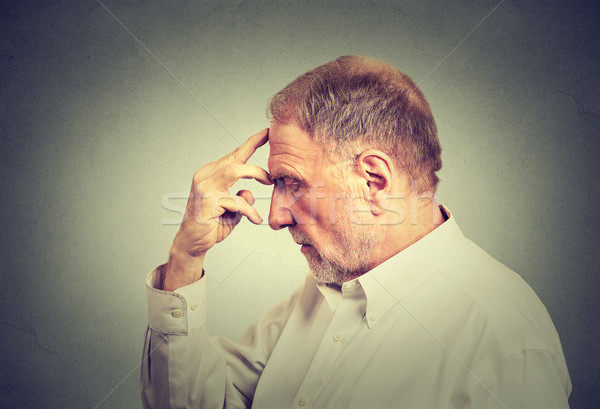 Closeup portrait of a senior thoughtful man isolated on gray wall background  Stock photo © ichiosea
