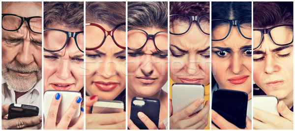 Pessoas do grupo homens mulheres óculos problema celular Foto stock © ichiosea