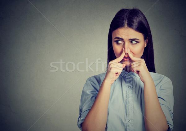 Vrouw neus vingers walging iets Stockfoto © ichiosea