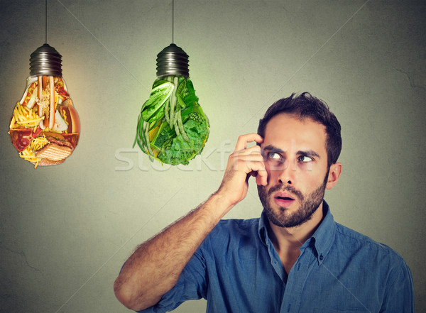 man thinking looking up at junk food green vegetables shaped as light bulb Stock photo © ichiosea