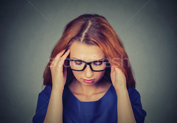 Portrait stressed young redhead business woman having headache Stock photo © ichiosea