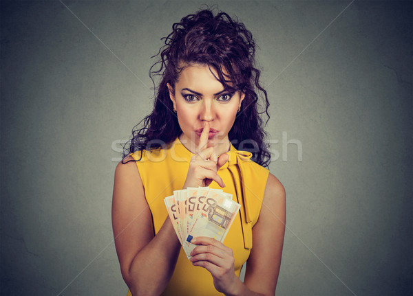 Corrupt, secretive woman with euro money showing shhh sign Stock photo © ichiosea