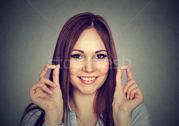 Noise control. Portrait young woman holding ear plugs  Stock photo © ichiosea