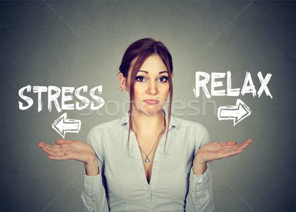 Stress or relax. Confused woman shrugging shoulders doesn't know  Stock photo © ichiosea