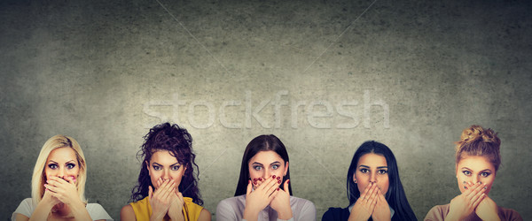 Group of women covering their mouth scared to speak out about abuse and domestic violence Stock photo © ichiosea