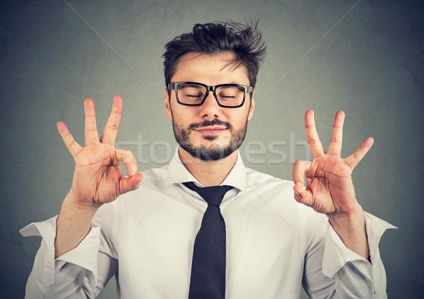 Moço meditando alegremente camisas óculos de mãos dadas Foto stock © ichiosea