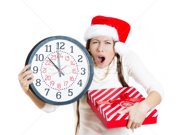 Young christmas woman holding clock and a gift box, running out of time, last minute shopping Stock photo © ichiosea
