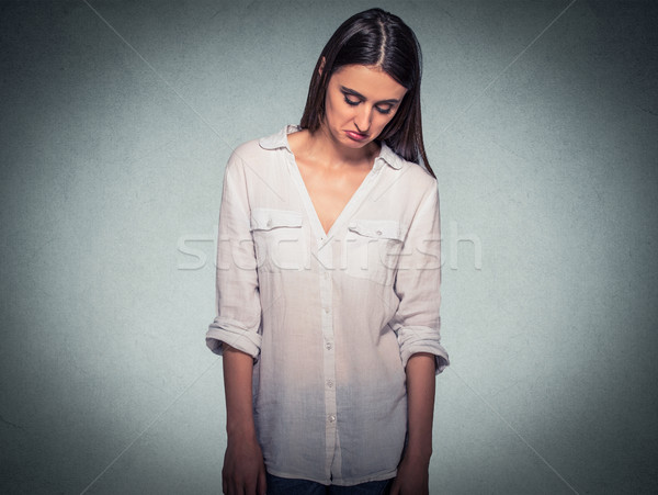Sad shy insecure woman looking down avoiding eye contact Stock photo © ichiosea