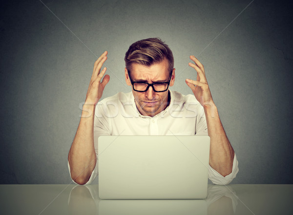 Stressed man working on computer.  Stock photo © ichiosea