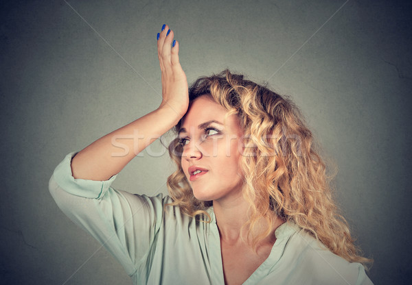 Regrets wrong. Woman slapping hand on head duh moment Stock photo © ichiosea