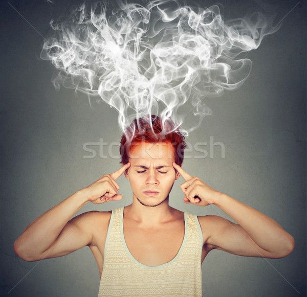man thinks very intensely having headache  Stock photo © ichiosea