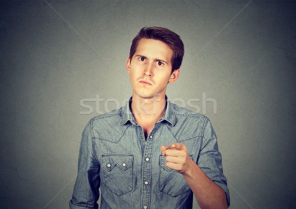 angry young man pointing finger at you camera  Stock photo © ichiosea