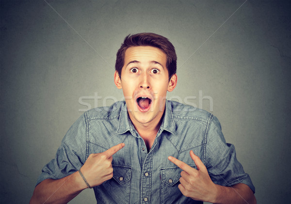 young happy surprised man pointing at himself you mean me  Stock photo © ichiosea