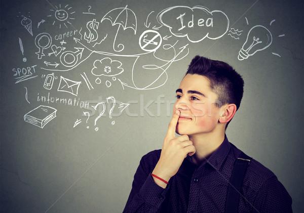 Boldog férfi gondolkodik álmodik sok ötletek Stock fotó © ichiosea
