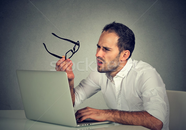 человека очки зрение путать ноутбука Сток-фото © ichiosea