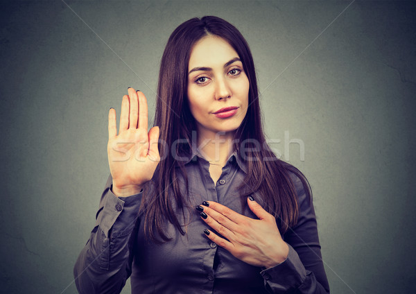 Woman making a promise or testifies   Stock photo © ichiosea