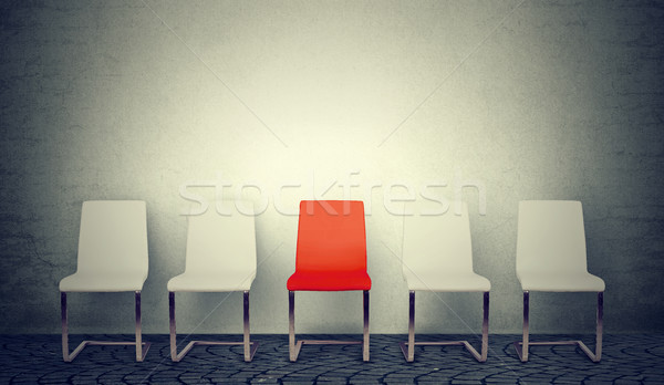 One opening for the job concept. Row of white chairs and one red in the middle  Stock photo © ichiosea