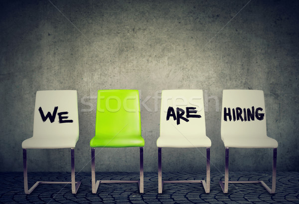 Opening for the job business concept. Row of white chairs and a green one  Stock photo © ichiosea