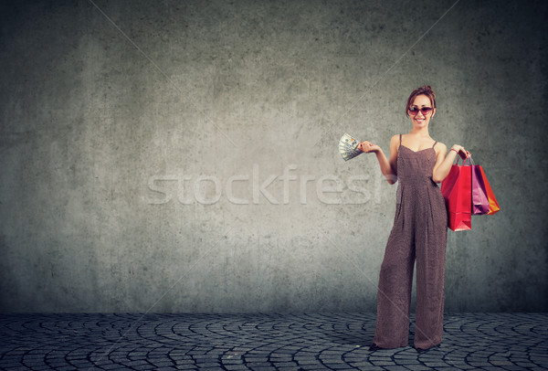 Trendy woman shopping and holding paper bags Stock photo © ichiosea