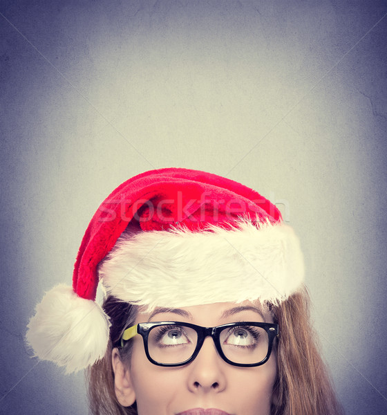 woman with red Santa Claus hat looking up Stock photo © ichiosea