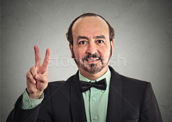 Сток-фото: бизнесмен · улыбаясь · победу · рукой · знак · портрет
