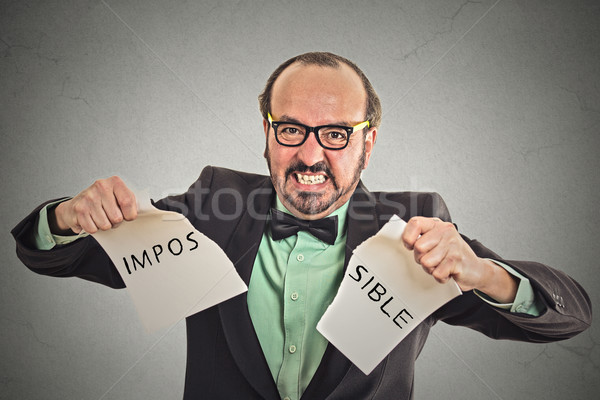 man tearing word impossible written on paper Stock photo © ichiosea