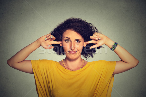 Annoyed upset angry woman plugging her ears with fingers doesn't want to listen Stock photo © ichiosea